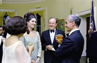 In conversation before State Dinner (foreground, L-R) Lady Bird Johnson (back to camera), Lynda Johnson, V.P. Hubert 