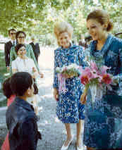 Children greet First Lady Patricia Nixon and the Shahbanou of Iran, 05/31/1972