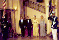 The Shah of Iran, President Nixon, the Shahbanou of Iran and Patricia Nixon participate in a formal pose during a State Dinner 07/24/1973