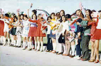 Students greet President Nixon and First Lady Patricia Nixon at Tehran Mehrabad Airport